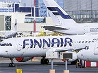 מטוסי חברת Finnair בנמל התעופה של הלסינקי / צילום: רויטרס