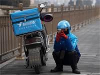 שליח אוכל בבייג'ינג, השבוע / צילום: NG Han Guan, AP