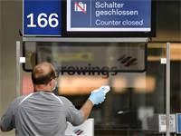 דלפק טיסות נכנסות סגור בשדה התעופה בדיסלדורף / צילום: Martin Meissner, Associated Press