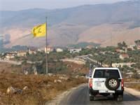 """רכב של יוניפי""""ל נוסע בדרום לבנון / צילום: Aziz Taher, רויטרס"""