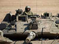 """צה""""ל בפעילות מבצעית בגבול רצועת עזה. / צילום: AP Photo Ariel Schalit"""
