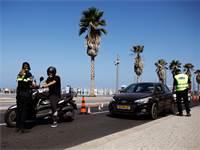 אכיפה משטרתית לפני כניסת יום כיפור בתל אביב / צילום: Corinna Kern, רויטרס