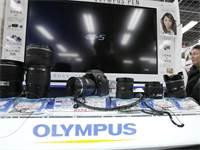 מוצרי הצילום של אולימפוס / צילום: Koji Sasahara, Associated Press