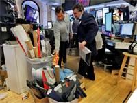 סוחרים בוול סטריט מפנים את העמדות לקראת חיטוי / צילום: Richard Drew, Associated Press