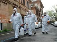 חיטוי של שכונה ברומא, איטליה / צילום: Mauro Scrobogna/LaPresse, AP