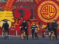 תושבים בבייג'ינג. / צילום: רויטרס, Yomiur