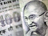 100 רופי, כסף, הודו, מהטמה גנדי / צלם בלומברג