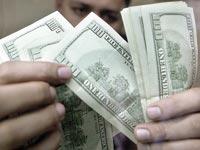 דולר,כסף, מזומן / צלם רויטרס