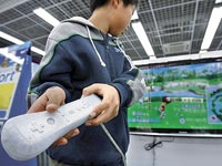 קונסולת משחק, משחקי וידאו, משחקי מחשב, Wii, נינטנדו / צלם רויטרס