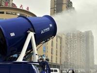 סין נלחמת בזיהום האוויר, זרנוקי מים / צילום: וידאו