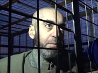 """שבויים תומכי אסד, עלווים כלואים בכלובים של דאע""""ש / צילום: וידאו"""