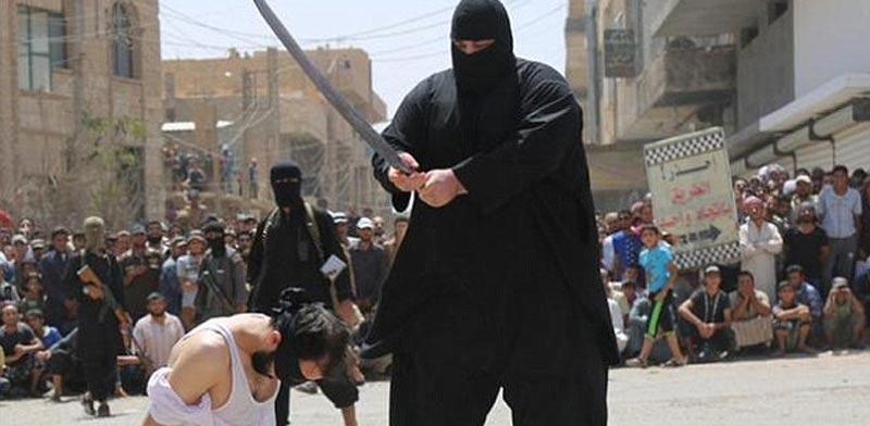 """""""הבולדוזר"""", המוציא להורג של דאע""""ש / צילום: מהוידאו"""