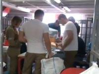 """פשיטה של המשטרה על אמל""""ח בדואר/ צילום: חדשות 2"""