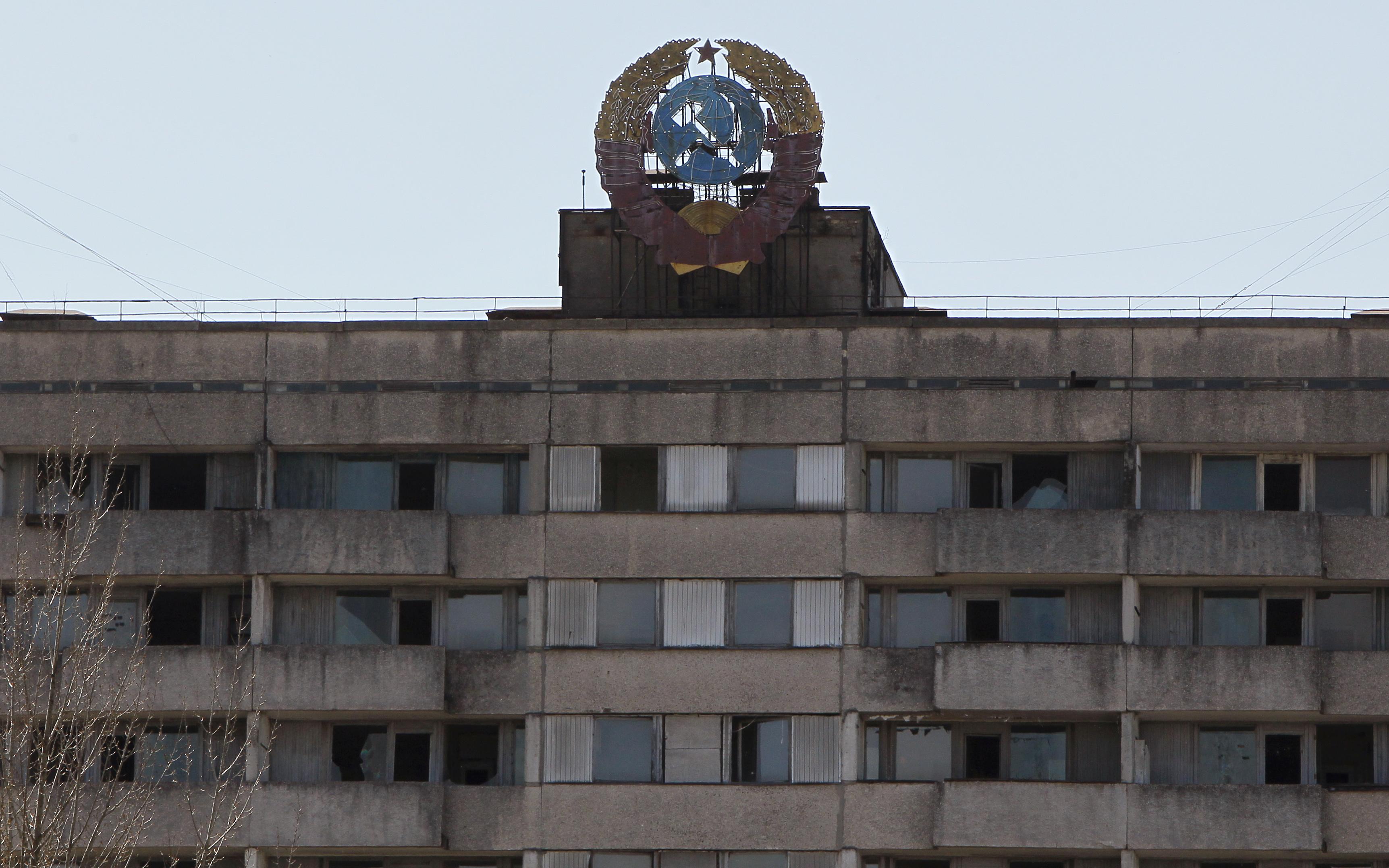 בניינים, גני ילדים וערים נטושות סביב צ'רנוביל / צילום: Gleb Garanich, רויטרס