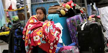 פליטה מוונצואלה בגבול אקוודור / צילום: רויטרס