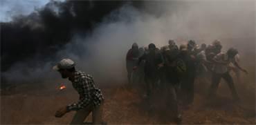 המהומות ברצועת עזה / צילום: איברהים אבו מוסטפה, רויטרס