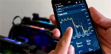 מסחר במטבעות דיגיטליים/צילום:  Shutterstock/ א.ס.א.פ קרייטיב