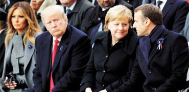 הנשיא טראמפ עם הקנצלרית מרקל והנשיא מאקרון/  צילום: רויטרס POOL New