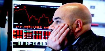 סוחר בבורסת ניו יורק / צילום: רויטרס, ברנדן מקדרמיד