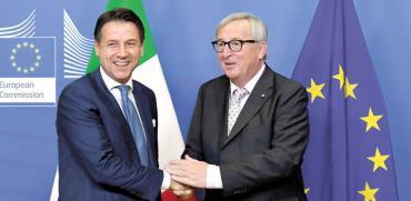 נשיא הנציבות האירופית וראש ממשלת איטליה/ צילום: רויטרס  Piroschka Van De Wouw
