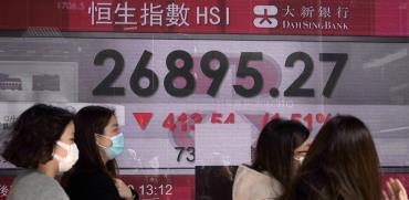 המניות באסיה צונחות על רקע הקורונה / צילום: Kin Cheung, Associated Press