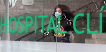 אישה בבית חולים בספרד שם אובחן מקרה קורונה / צילום: נאצ'ו דוצ'ה, רויטרס