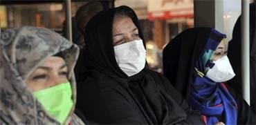 אזרחות איראניות לובשות מסכות מגן / צילום: Ebrahim Noroozi, AP
