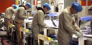 מפעל ייצור בסין. / צילום   AP   ASSOCIATED PRESS