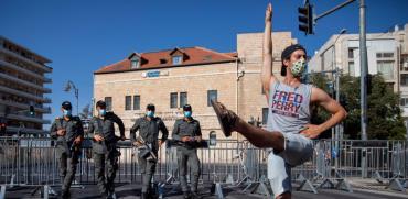 מפגין בבלפור / צילום: AP - Oded Balilty