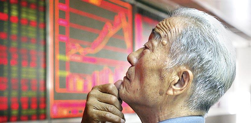 משקיע סיני / צילום: רויטרס