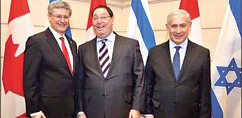 נתן ג'ייקובסון במרכז עם בנימין נתניהו וסטיבן הרפר ראש ממשלת קנדה/ צילום:  PMO