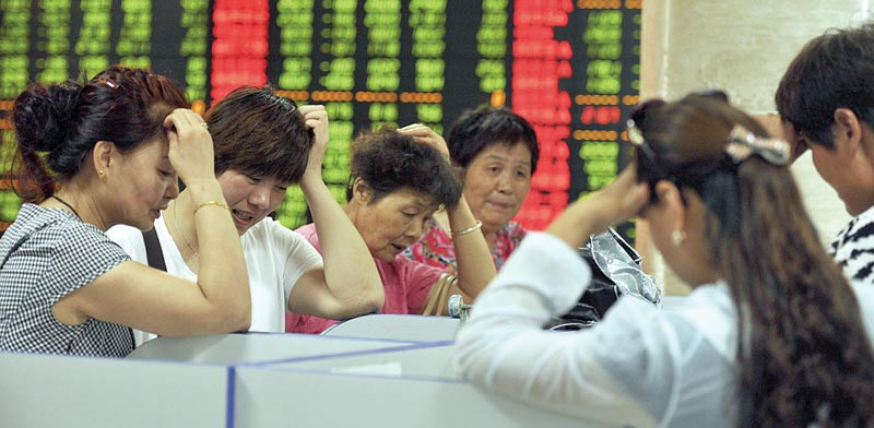 משקיעים סיניים / צילום: רויטרס
