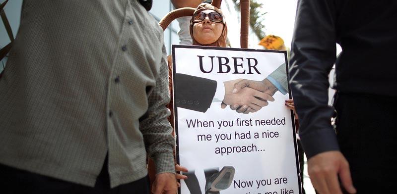 עובדי אובר מפגינים על תנאי העבודה / צילום: רויטרס