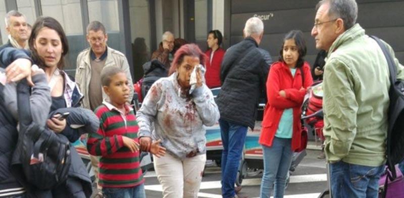 פצועה בורחת מאזור הפיגוע בבריסל  / צילום: רויטרס