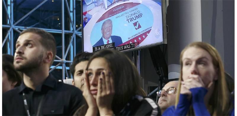 תומכי קלינטון המומים לנוכח ניצחון טראמפ בפלורידה (צילום: רויטרס)