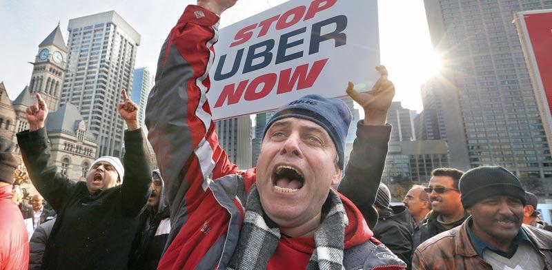 """מפגינים נגד אובר בארה""""ב / צילום: רויטרס"""