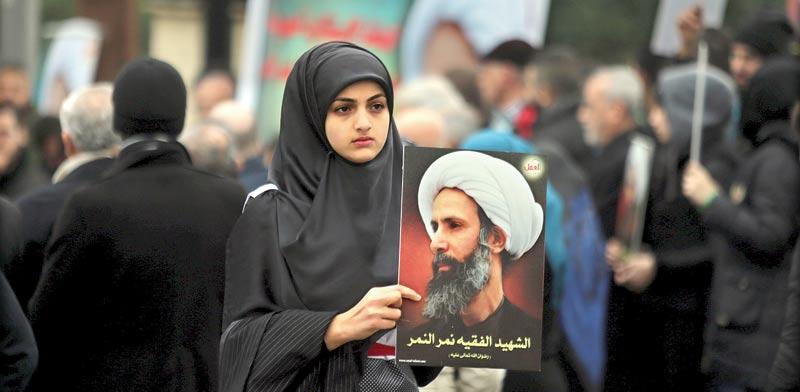 מפגינה בלבנון נגד הרצח / צילום: רויטרס
