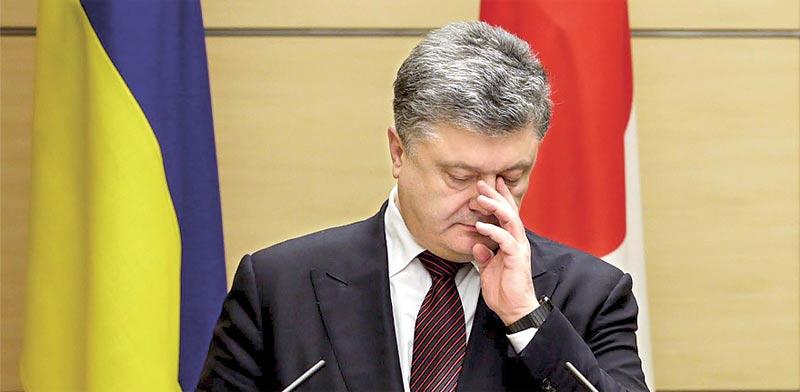 נשיא אוקראינה פורושנקו, אתמול (ד'). טוען שלא עשה כל רע / צילום: רויטרס