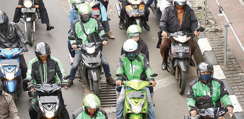 השירות של Go-Jek. יותר מ–200 אלף אופנועים / צילום: בלומברג