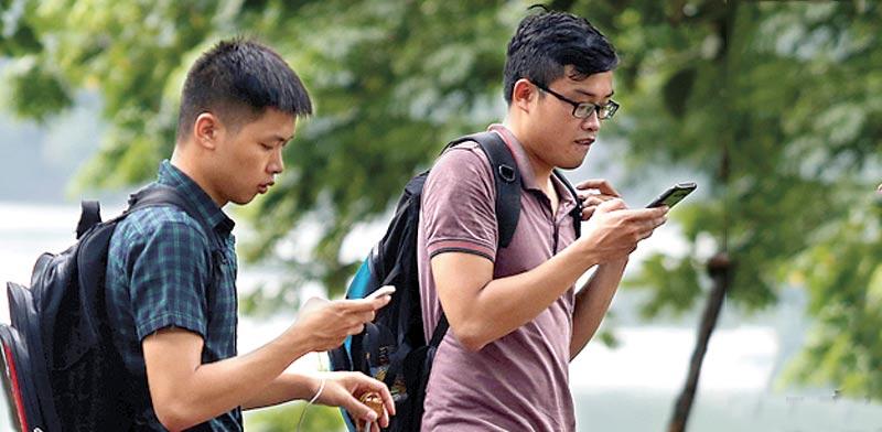 שחקני פוקימון גו בווייטנאם / צילום: רויטרס