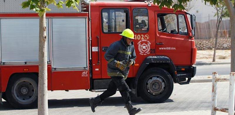 נפילת גראד קטיושה בבאר שבע חמאס פיגוע מכבי אש שריפה / צלם : רויטרס