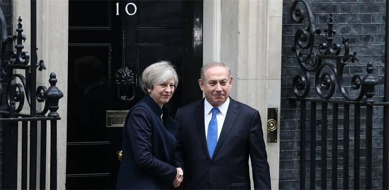 ראש המממשלה בנימין נתניהו וראש ממשלת בריטניה תרזה מיי / צילום: Neil Hall, רויטרס
