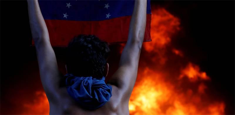 מהומות בונצואלה/ צילום: רוייטרס