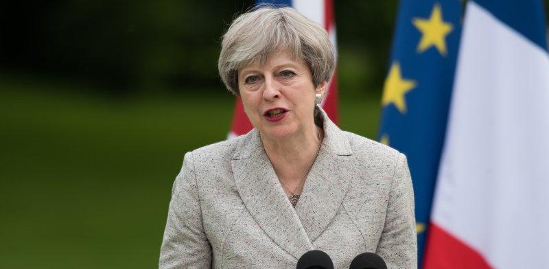 ראש ממשלת בריטניה, תרזה מיי / צילום: שאטרסטוק, א.ס.א.פ קריאייטיב