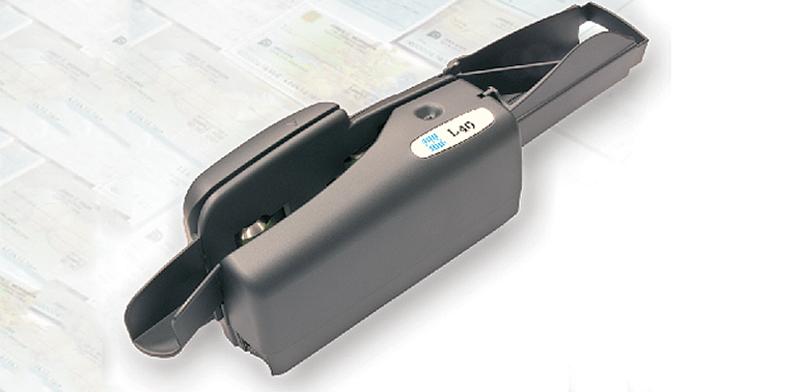 מכשיר קריאת צ'קים של וואן טכנולוגיות / צילום: אתר החברה