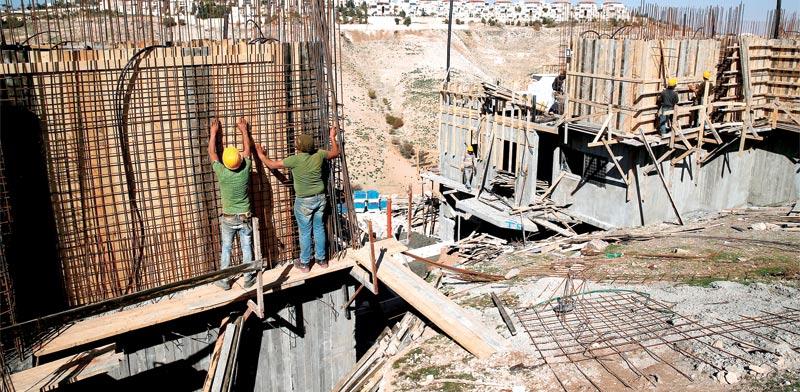 בנייה בשטחים / צילום: רויטרס