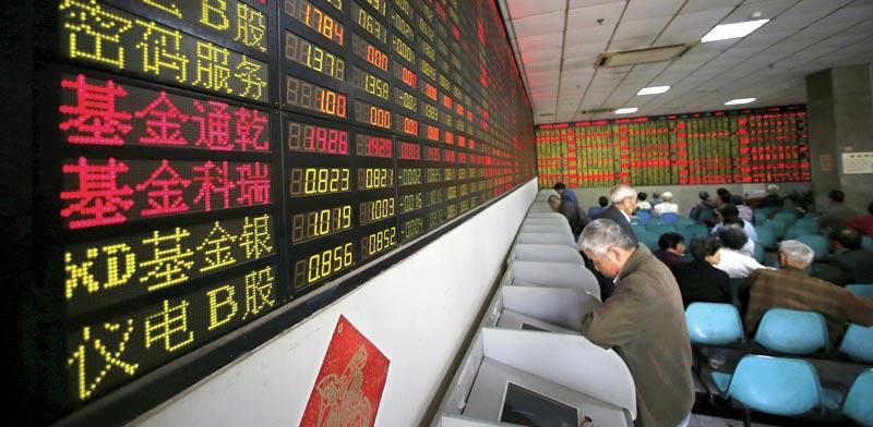 חדר מסחר בשנחאי / צילום: רויטרס