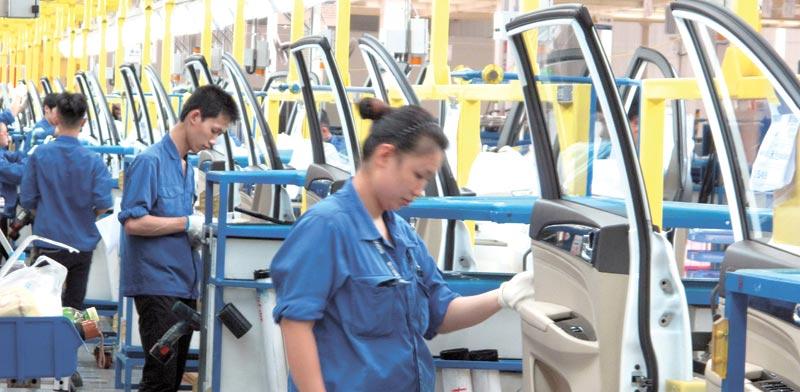 מפעל של חברת סאייק בסין. תחרות פנימית אדירהצילום: רויטרס