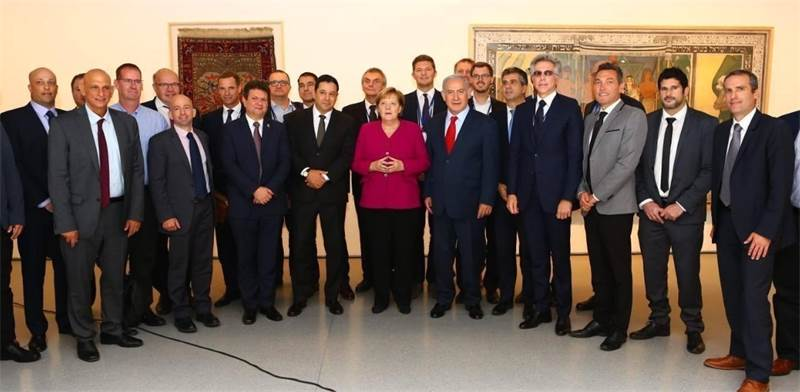 Merkel, Netanyahu  flanked by innovation executives Photo: GPO