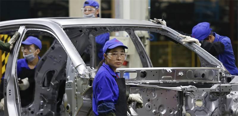 פועלים סינים/ צילום: רויטרס